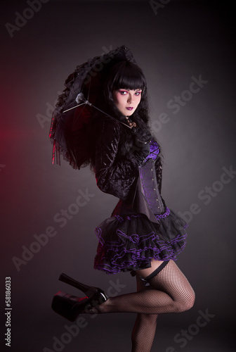 Portrait of gothic Lolita girl with umbrella