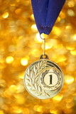 golden medal on shiny background