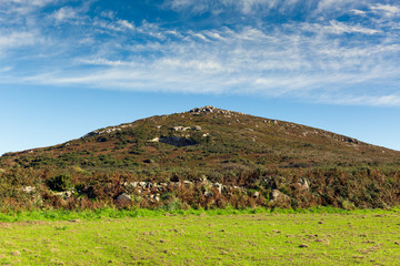 Blue sky white clouds and hillside Cornwall Zennor