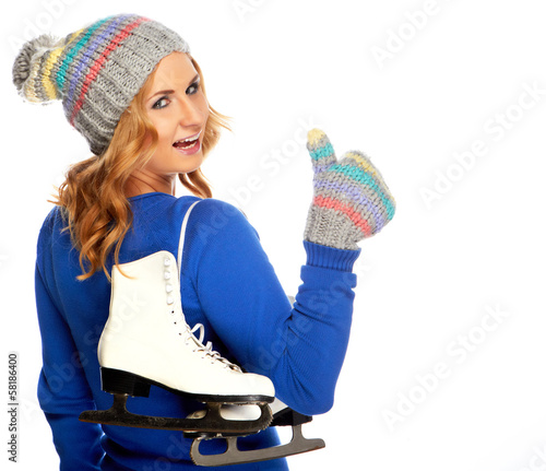 Beautiful happy young woman goes ice-skating