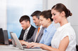 Businesspeople In A Row Working Together At Office
