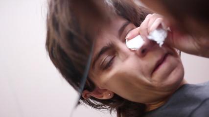 Woman crying before broken mirror symbolized her broken life.