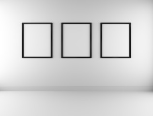 Three blank picture frames on wall