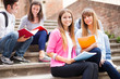 Smiling students sitting on stairs