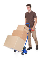 Delivery Man With Hand Truck And Boxes