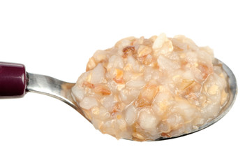 Boiled Buckwheat on Spoon on White Background