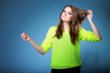 Attractive girl in bright vivid colour sweater