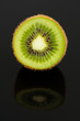 Half of Kiwi Fruit with Reflection on Black Background