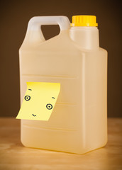 Post-it note with smiley face sticked on a gallon