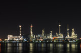Petrochemical refinery plant illuminated at night