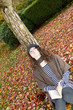 Teen Girl thinking while outside in the Autumn Season