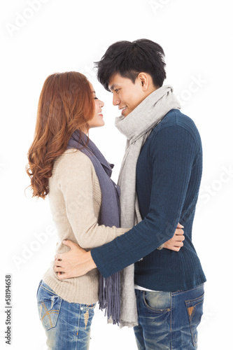 happy young couple hugging together