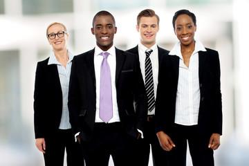 Team of corporate associates posing