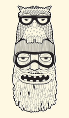 bearded man in ski-glasses with owl on his head