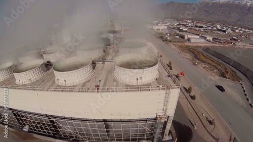 Aerial fly by of natural gas power plant steam scrubbers