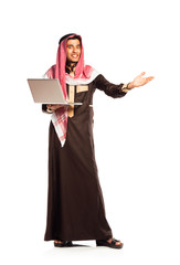 Young smiling arab with laptop isolated on white