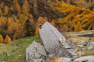 Old bivouac hut in the Italian alps.