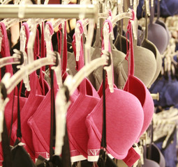 Row of bras hanging in lingerie store