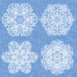 Set of four lace decorative ornaments