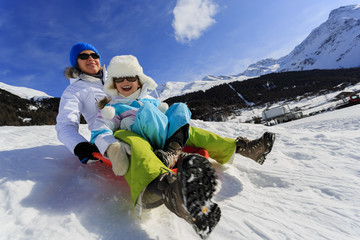 Winter fun - family sledding at winter time