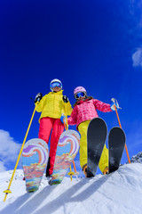 Ski and fun  - family enjoying winter holidays