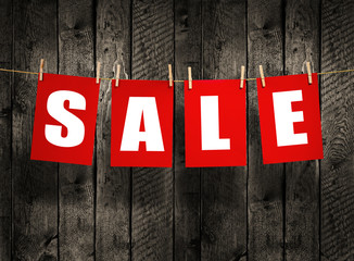 SALE on wood background