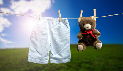 Baby boy pants, a teddy bear on the outdoor clothesline