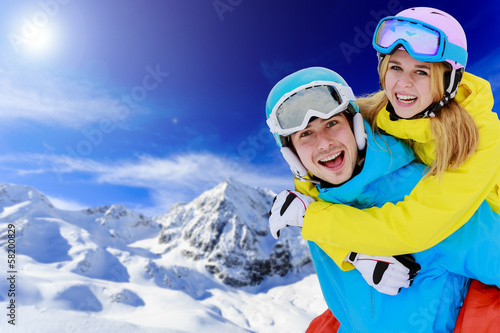 Skiing, winter sports, couple having fun on ski