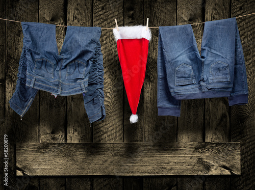 Jeans, santa hat, on clothesline