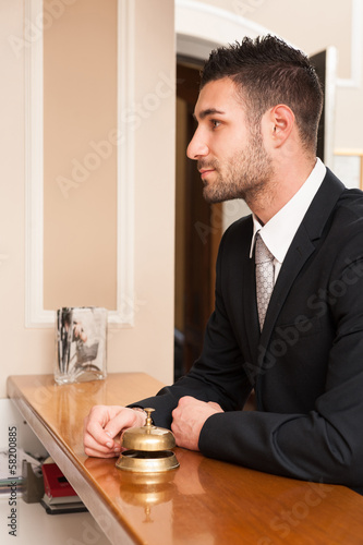 Young businessman waiting at hotel reception.