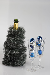 Decorated bottle of champagne and glasses