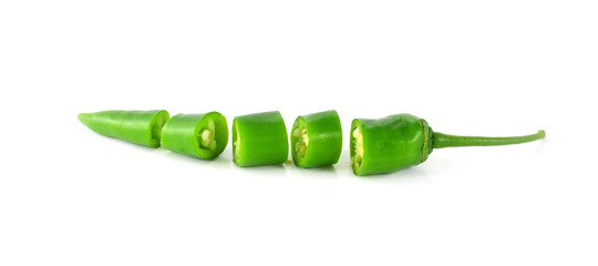 fresh green cut chili pepper pieces on a white background