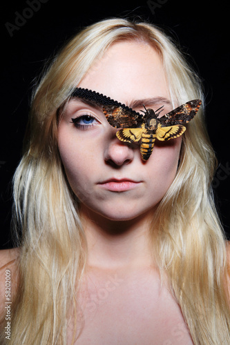 blonde girl with butterfly eyepatch