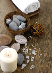 Spa concept with zen stones in bowl ,candle ,towel