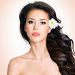Face of beautiful woman with a  flower