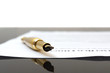 contract with gold fountain pen with white background