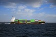 Container ship sailing in open waters