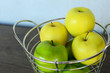 Green and Yellow Apples in Basket