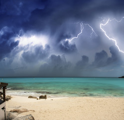 Beautiful beach at night with thunderstorm approaching