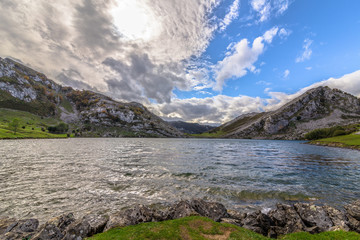 Enol lake surrounded by mountains on a cloudy day in Asturias