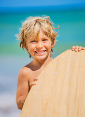 Happy Young boy having fun at the beach on vacation