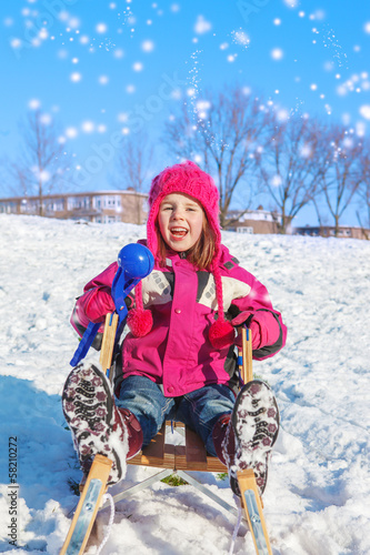 Girl with a snowball maker