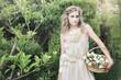 Beautiful bride in garden, in silk dress