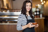 Beautiful Waitress Holding Coffee Cup In Cafeteria