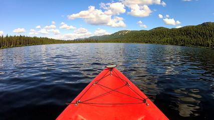 POV adventurous view of  Kayak remote lake, USA