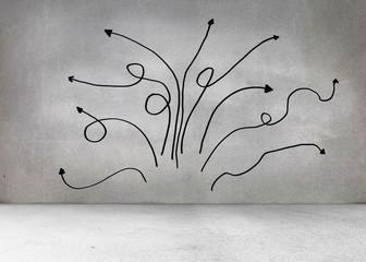 Grey wall with arrows