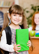portrait of pretty preschool girl with backpack