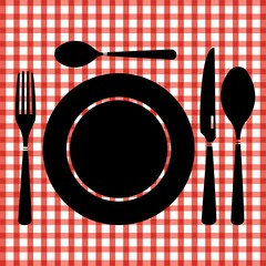 Table set on red checked tablecloth