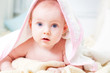 Little baby under rose towel