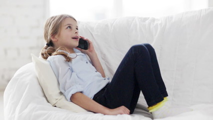 little child girl with smartphone at home
